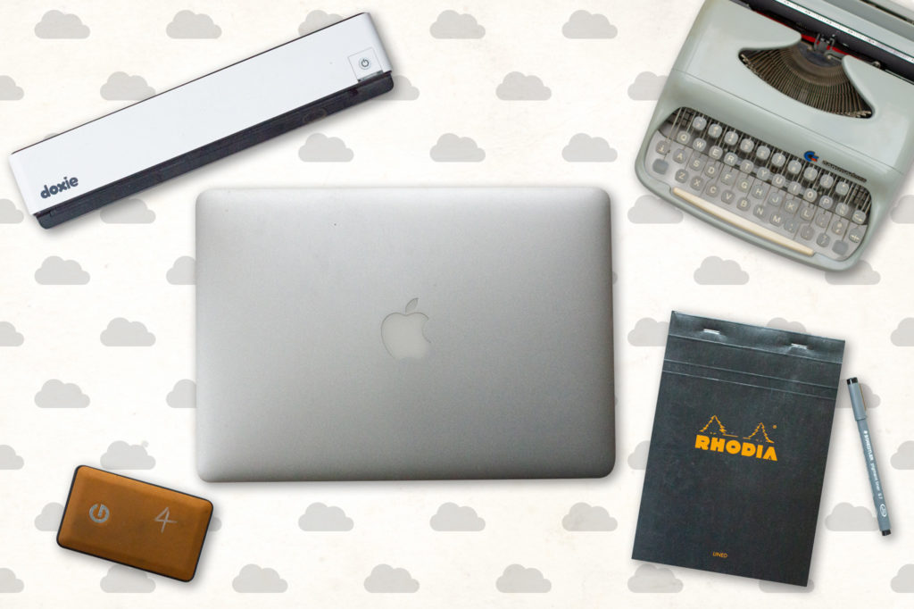 doxie scanner, macbook air, hard drive, typewriter, note pad, pen